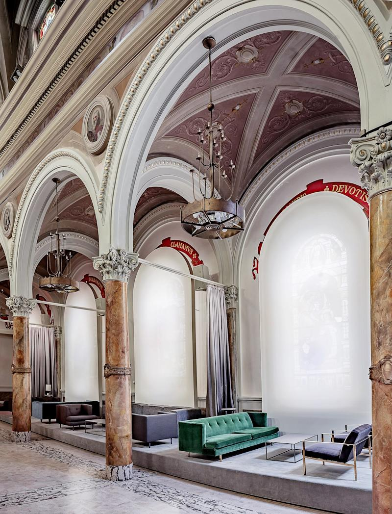 The furniture in the space was specifically chosen to not clash with the existing colors and fixtures from the original church.