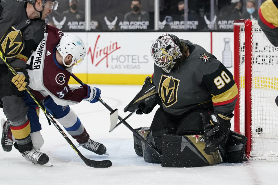 Colorado Avalanche left wing J.T. Compher (37) scores a goal against Vegas Golden Knights goaltender Robin Lehner (90) during the third period of an NHL hockey game Monday, May 10, 2021, in Las Vegas. (AP Photo/John Locher)