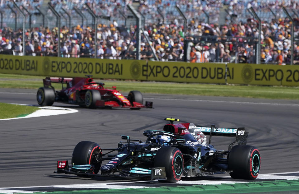 Mercedes driver Valtteri Bottas of Finland steers his car followed by Ferrari driver Charles Leclerc of Monaco during the Sprint Qualifying of the British Formula One Grand Prix, at the Silverstone circuit, in Silverstone, England, Saturday, July 17, 2021. The British Formula One Grand Prix will be held on Sunday. (AP Photo/Jon Super)