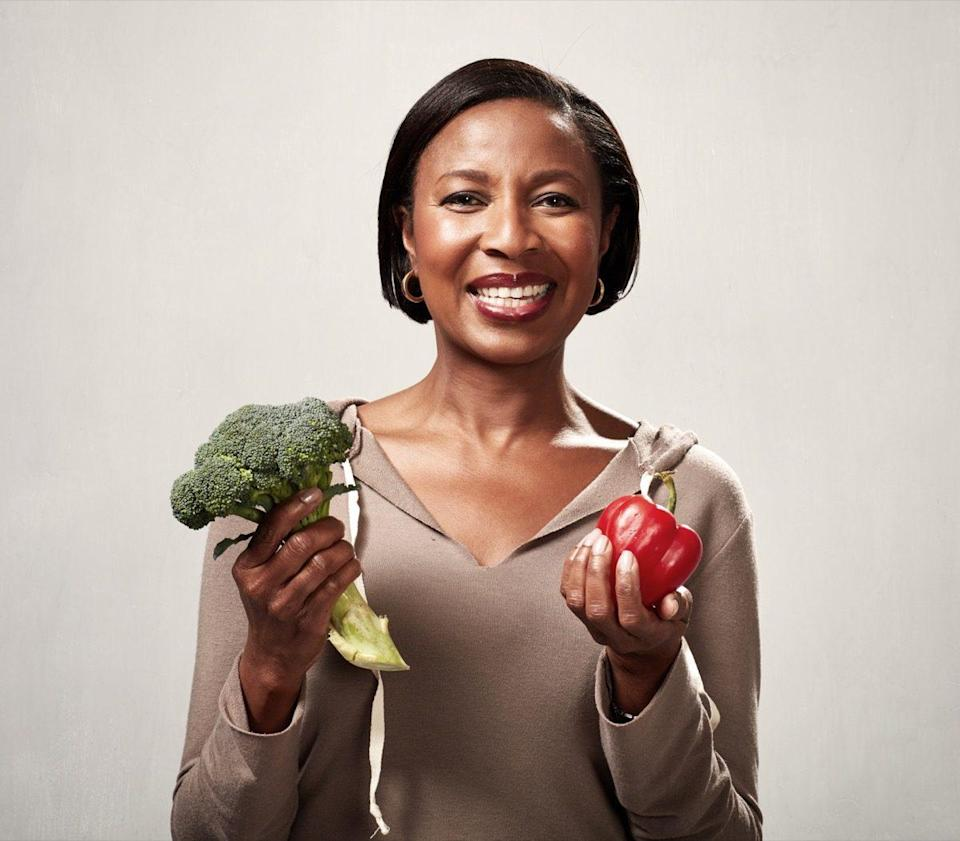 African american woman with broccoli