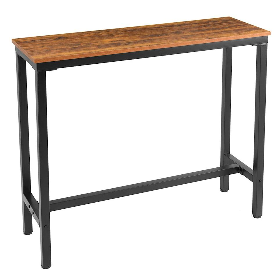 """<h3><a href=""""https://www.amazon.com/Mr-IRONSTONE-Dining-Vintage-Textured/dp/B07P3H4P1D/ref=pd_sbs_196_6/144-6911541-3363744"""" rel=""""nofollow noopener"""" target=""""_blank"""" data-ylk=""""slk:Mr. Ironstone Bistro Bar Table"""" class=""""link rapid-noclick-resp"""">Mr. Ironstone Bistro Bar Table</a> </h3><br>The beauty of a tall table with an unencumbered frame is that it can be used as both a small-space workstation and a bar-style dining table in a pinch.<br><br><strong>Mr. Ironstone</strong> Bar Table (47""""), $, available at <a href=""""https://www.amazon.com/Mr-IRONSTONE-Dining-Vintage-Textured/dp/B07P3H4P1D/ref=pd_sbs_196_6/144-6911541-3363744"""" rel=""""nofollow noopener"""" target=""""_blank"""" data-ylk=""""slk:Amazon"""" class=""""link rapid-noclick-resp"""">Amazon</a>"""