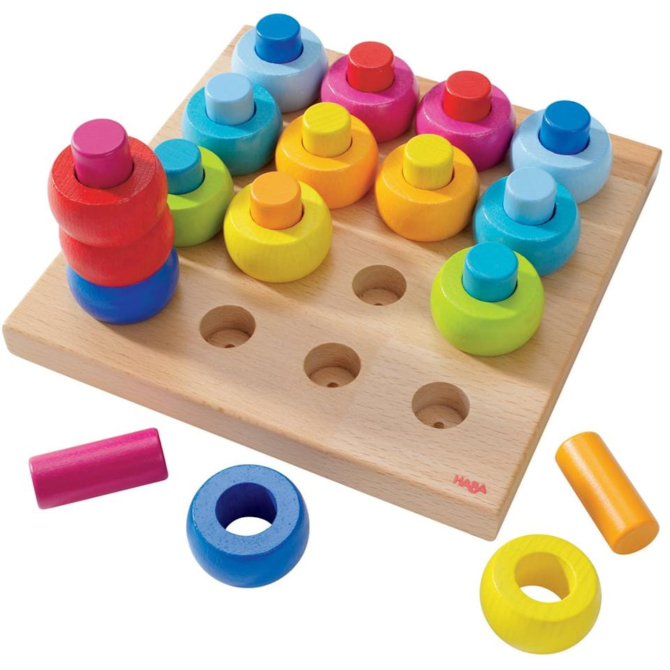 """<p>Haba's <a href=""""https://www.popsugar.com/buy/Rainbow-Whirls-Pegging-Game-397243?p_name=Rainbow%20Whirls%20Pegging%20Game&retailer=walmart.com&pid=397243&price=25&evar1=moms%3Aus&evar9=45985816&evar98=https%3A%2F%2Fwww.popsugar.com%2Fphoto-gallery%2F45985816%2Fimage%2F45985947%2FHaba-Rainbow-Whirls-Pegging-Game&list1=gifts%2Choliday%2Ctoys%2Cgift%20guide%2Ctoddlers%2Cbabies%2Chaba%2Cgifts%20for%20kids%2Clittle%20kids%2Ckid%20shopping%2Choliday%20living%2Choliday%20for%20kids%2Cbaby%20shopping%2Cgifts%20for%20babies%2Cbest%20of%202019&prop13=api&pdata=1"""" rel=""""nofollow"""" data-shoppable-link=""""1"""" target=""""_blank"""" class=""""ga-track"""" data-ga-category=""""Related"""" data-ga-label=""""https://www.walmart.com/ip/HABA-Palette-of-Pegs-32-Piece-Wooden-Pegging-Arranging-Game-for-Ages-2-and-Up/881993744?wmlspartner=wlpa&amp;selectedSellerId=2593&amp;adid=22222222227140873187&amp;wl0=&amp;wl1=g&amp;wl2=c&amp;wl3=251137855859&amp;wl4=pla-411982562866&amp;wl5=1014221&amp;wl6=&amp;wl7=&amp;wl8=&amp;wl9=pla&amp;wl10=113505992&amp;wl11=online&amp;wl12=881993744&amp;wl13=&amp;veh=sem&amp;gclid=EAIaIQobChMIwunt8Z-W3wIVYR6tBh2OHQtAEAQYAiABEgKJBfD_BwE"""" data-ga-action=""""In-Line Links"""">Rainbow Whirls Pegging Game</a> ($25) is a fun take on the classic stacking rings. It's a combination puzzle and ring game, so tots can pile up the rings by color or any other category they see fit.</p>"""