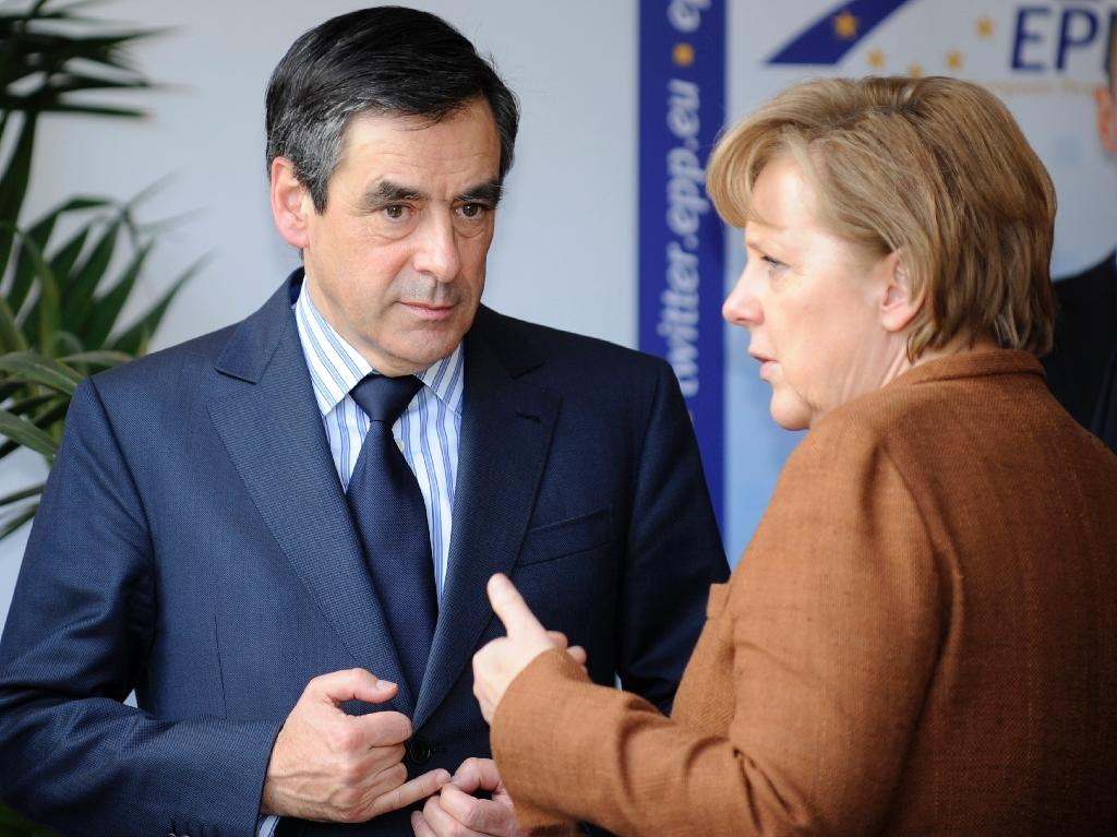 François Fillon and Angela Merkel disagree on a number of issues -- such as gay marriage and how Europe should be run (AFP Photo/Jean-Christophe Verhaegen)