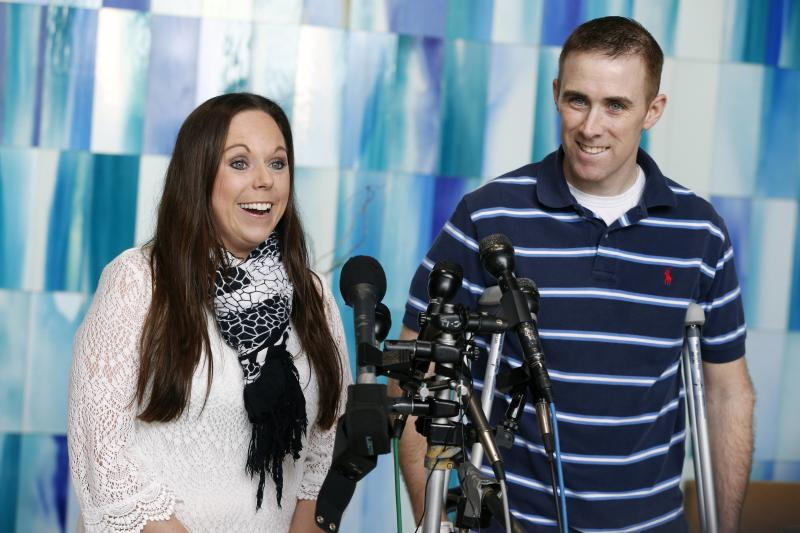 Transit police officer Richard Donohue, right, and his wife Kim speak with reporters before leaving Spaulding Rehabilitation Hospital in Boston, Friday, June 14, 2013. Dononhue was injured during a shoot-out with the Boston Marathon bombing suspects. (AP Photo/Michael Dwyer)
