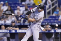 New York Yankees' Joey Gallo strikes out swinging during the first inning of a baseball game against the Miami Marlins, Sunday, Aug. 1, 2021, in Miami. (AP Photo/Lynne Sladky)