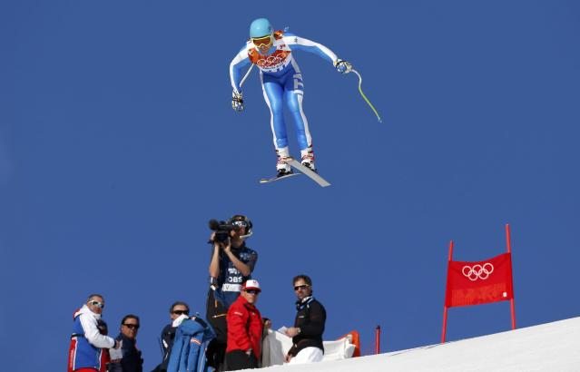 Italy's Christof Innerhofer goes airborne during the downhill run of the men's alpine skiing super combined event at the 2014 Sochi Winter Olympics at the Rosa Khutor Alpine Center February 14, 2014. REUTERS/Stefano Rellandini (RUSSIA - Tags: SPORT SKIING OLYMPICS)