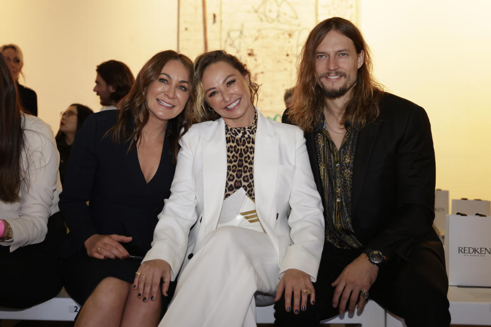 Michelle Bridges, Camilla Franks and David Genat sit front row at the Rebecca Vallance show during Afterpay Australian Fashion Week 2021 Resort '22 Collections at Carriageworks on May 31, 2021 in Sydney, Australia