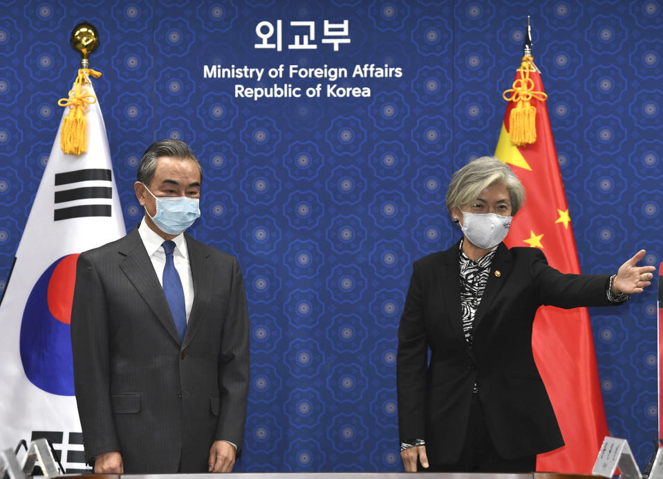 South Korean Foreign Minister Kang Kyung-wha, right, gestures to Chinese Foreign Minister Wang Yi, prior their meeting at the foreign ministry in Seoul, South Korea, Thursday, Nov. 26, 2020. Wang arrived in Seoul on Nov. 25, for a three-day state visit.(Kim Min-hee/Pool Photo via AP)