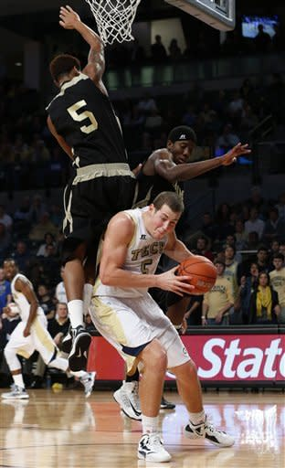 Georgia Tech center Daniel Miller looks for a shot as Alabama State's Bobby Brown (5) and Luther Page, right, defend during the first half of an NCAA college basketball game Monday, Dec. 17, 2012, in Atlanta. (AP Photo/John Bazemore)