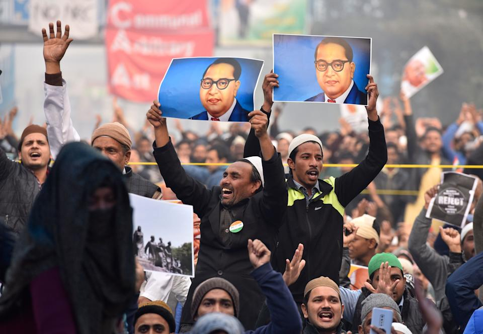 NEW DELHI, INDIA - DECEMBER 20: Protestors hold placards during a demonstration against the Citizenship Amendment Act (CAA) at Shaheenbagh, Jamia Nagar on December 20, 2019 in New Delhi, India. (Photo: Hindustan Times via Getty Images)