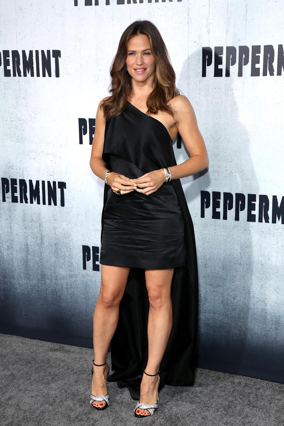 <p>The Hollywood star opted to wear a one-shoulder black dress with a train to the premiere of her new film. <em>[Photo: Getty]</em> </p>