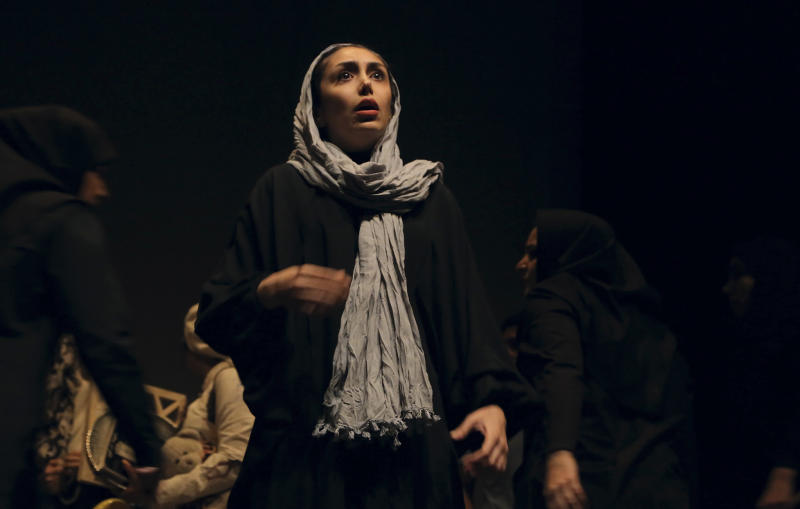 "In this undated photo, Iranian actress Sami Moslemi performs a scene from ""The Blue Feeling of Death,'' in Arasbaran Cultural Center in Tehran, Iran. The production, translated from Farsi as ""The Blue Feeling of Death,"" opened last month as a showcase of activist art against Iran's legal codes that allow death sentences for children — who then wait until their 18th birthday for possible execution. Opening night came even as Iranian officials tightened controls on the social media and other forms of political opposition before presidential elections, whose centrist winner, Hasan Rouhani, has brought hope of reversing some of the crackdowns. (AP Photo/Hadi Shabani)"