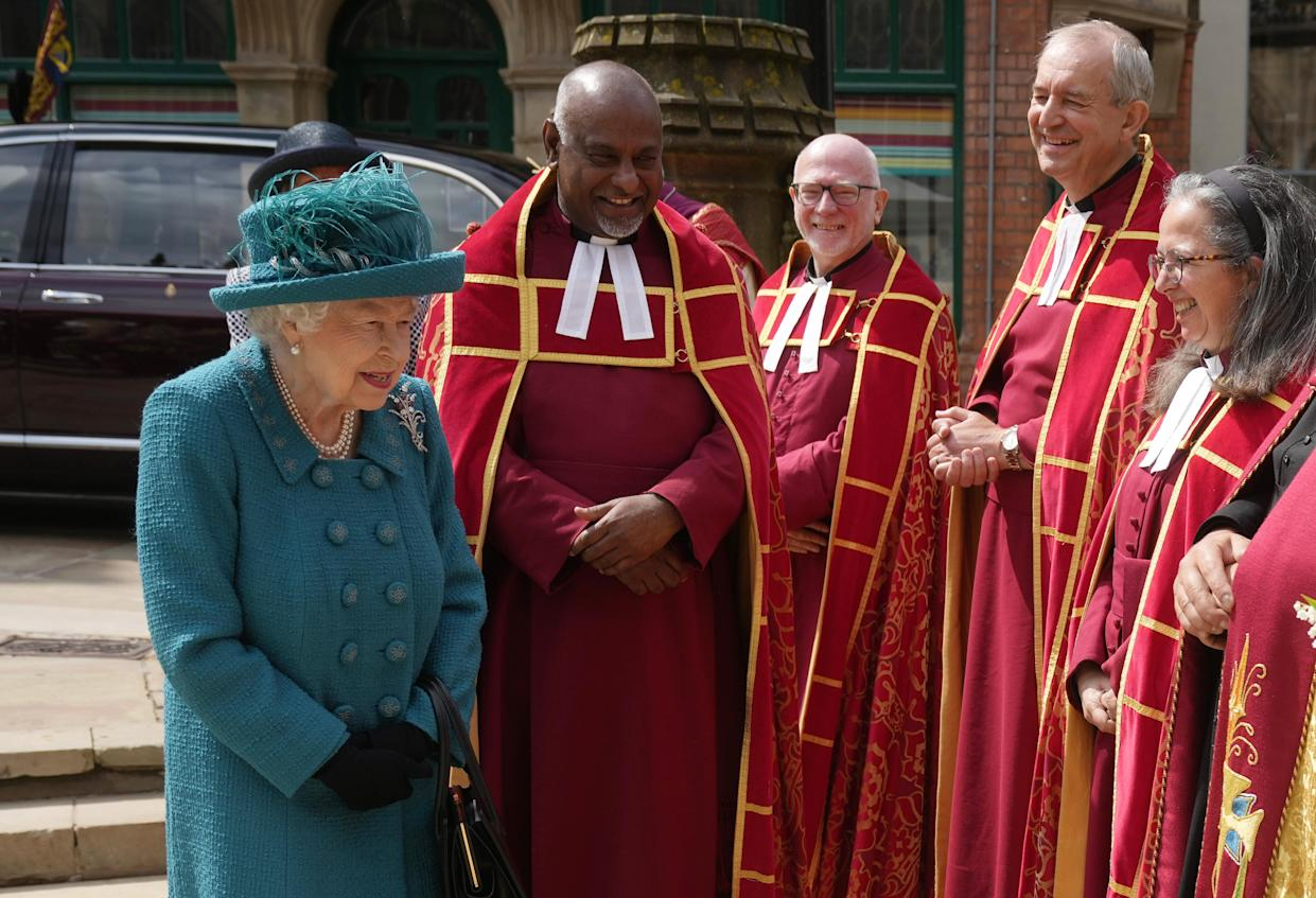 MANCHESTER, ENGLAND - JULY 08: (EDITORS NOTE: This image is a recrop of #1233866596) Queen Elizabeth II is introduced to members of the clergy by Dean of Manchester Cathedral, Rogers Govender as she visits Manchester Cathedral on July 8, 2021 in Manchester, England. (Photo by Christopher Furlong/Getty Images)