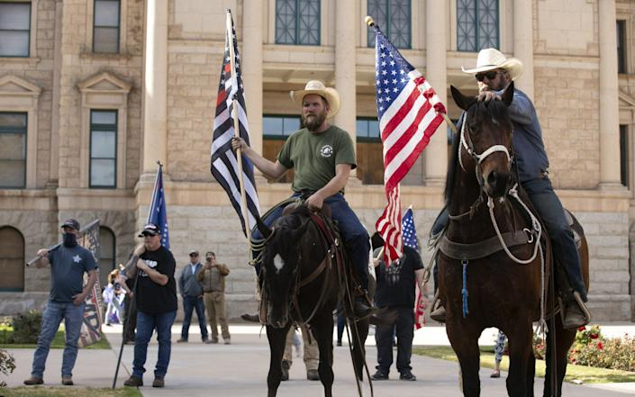 People on horseback participate in a pro-Trump rally at the state Capitol in Phoenix, Arizona - USA TODAY Network /Sipa USA
