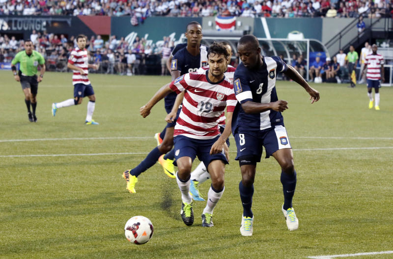 Belize's Elroy Smith, right, and United States' Chris Wondolowski chase down the ball during the first half of their CONCACAF Gold Cup soccer game in Portland, Oregon Tuesday, July 9, 2013.(AP Photo/Don Ryan)