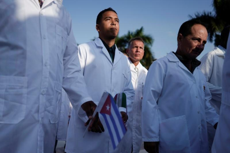 Cuban doctors take part in a farewell ceremony before departing to Italy to assist, amid concerns about the spread of the coronavirus disease outbreak