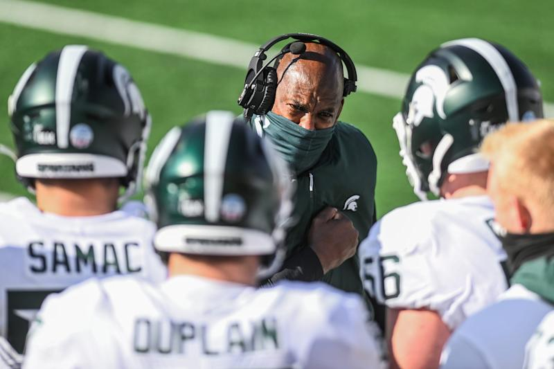 Michigan State's head coach Mel Tucker talks with the offensive line during the third quarter of the game against Michigan on Saturday, Oct. 31, 2020, at Michigan Stadium in Ann Arbor.