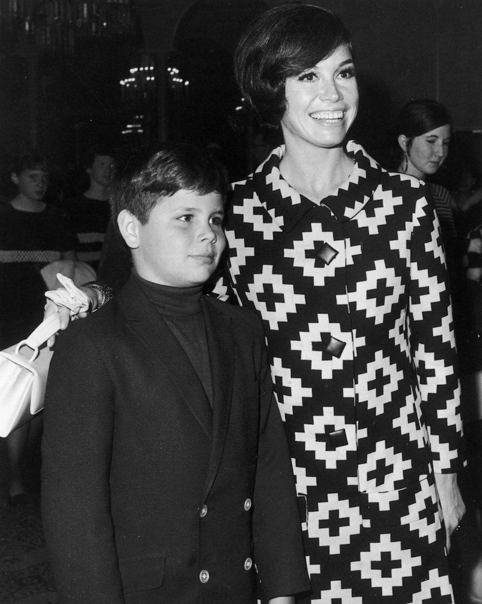 <p>Moore poses with her son, Richard Meeker Jr., at a Teach Foundation benefit.</p>