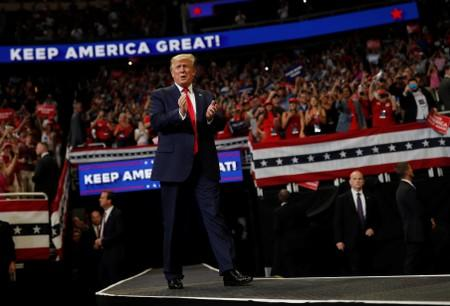 U.S. President Donald Trump reacts on stage formally kicking off his re-election bid with a campaign rally in Orlando