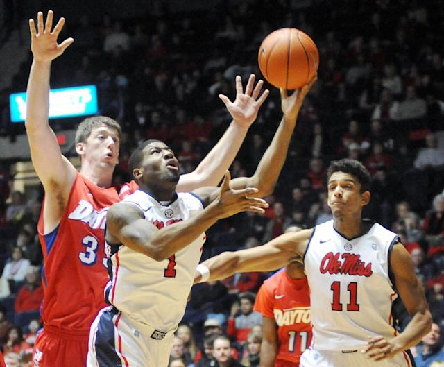 Mississippi's Martavious Newby (1) scores as Dayton's Matt Kavanaugh (35) defends in front of Mississippi's Sebastian Saiz (11) during an NCAA college basketball game in Oxford, Miss., Saturday, Jan. 4, 2014. (AP Photo/Oxford Eagle, Bruce Newman)