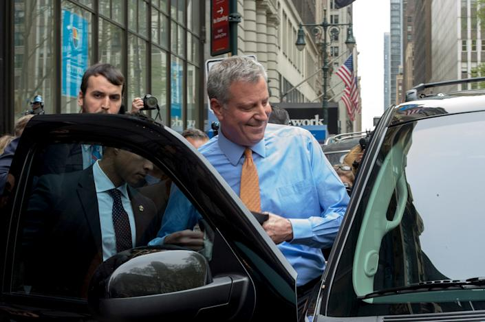 New York Mayor Bill de Blasio gets into his SUV after visiting an event at Guttman Community College in 2016. (Bryan Smith/ZUMA Wire)