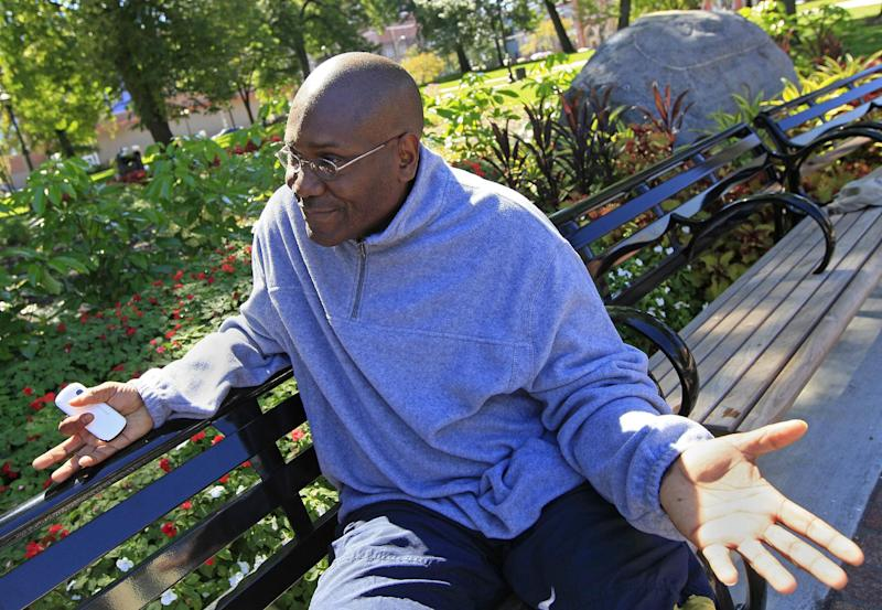 In this photo taken Sept. 24, 2012, Rod Davis is interviewed at Washington Park in Cincinnati. A truck driver on disability, Davis said he isn't happy with the state of the economy, but figures it's better to give Obama more time. Winning Ohio is complicated, with its variety of voter groups and swinging trends. Diverse in geography, economy and demographics, Ohio is a state that one political scientist says offers a fairly close mirror of the nation. History and electoral math say the swing state is pivotal again this year, and probably crucial for Mitt Romney to win. President Barack Obama is trying to repeat his 2008 victory. (AP Photo/Al Behrman)
