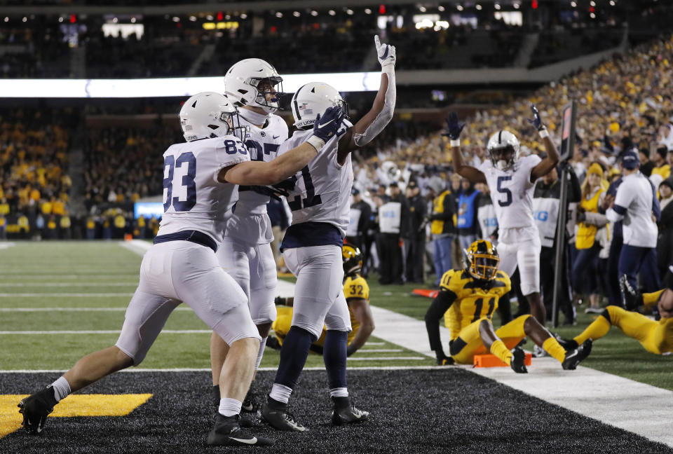 Penn State running back Noah Cain, center, celebrates his touchdown during the second half of the team's NCAA college football game against Iowa on Saturday, Oct. 12, 2019, in Iowa City, Iowa. (AP Photo/Matthew Putney)