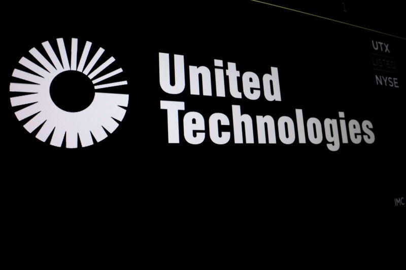 United Technologies logo is displayed on a screen at the post where it's stock is traded on the floor of the NYSE in New York