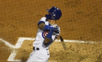 Chicago Cubs' Javier Baez (9) hits a home run against the Cleveland Indians during the second inning of a baseball game, Tuesday, Sept.15, 2020, in Chicago. (AP Photo/David Banks)