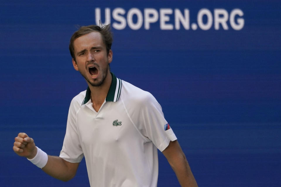 Daniil Medvedev, of Russia, reacts after scoring a point against Botic Van de Zandschulp, of the Netherlands, during the quarterfinals of the US Open tennis championships, Tuesday, Sept. 7, 2021, in New York. (AP Photo/Elise Amendola)