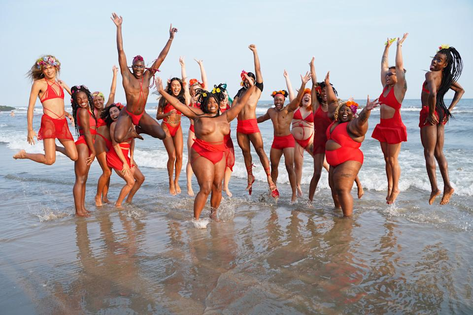 Hart, at center, wades in the Atlantic after walking in the Chromat x Tourmaline Spring/Summer 2022 Runway Show at Riis Beach Park on Sunday. (Photo: Sean Zanni/Getty Images for Chromat)