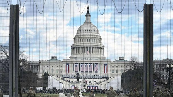 PHOTO: Heightened security is seen in front of the United States Capitol on the morning of Joe Biden's Inauguration as the 46th President of the United States, Jan. 20, 2021 in Washington. The mall was closed to the general public due to safety concerns. (The Washington Post via Getty Images)