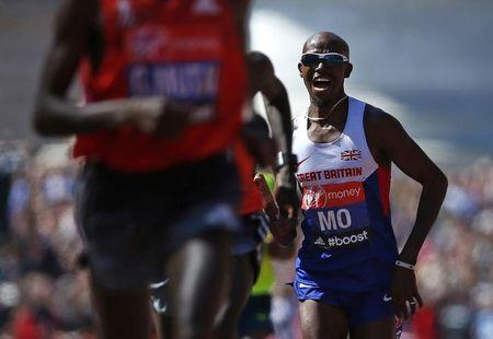 Mo Farah of Britain sprints down The Mall before finishing in eighth position in the men's Elite London Marathon