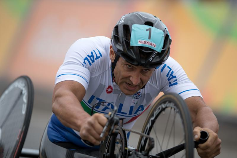 Italy's Alessandro Zanardi competes during the men's team relay H2-5 road cycling final at the Rio 2016 Paralympic games at Pontal beach in Rio de Janeiro, Brazil, Sept. 16, 2016. Italy's team Vittorio Pedestal, Luca Mazzone and Zanardi won the gold medal.(AP Photo/Mauro Pimentel)