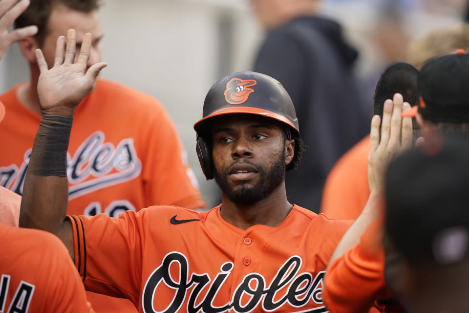 Baltimore Orioles center fielder Cedric Mullins is greeted in the dugout after scoring from second on a single by teammate Ryan Mountcastle during the third inning of a baseball game against the Detroit Tigers, Saturday, July 31, 2021, in Detroit. (AP Photo/Carlos Osorio)