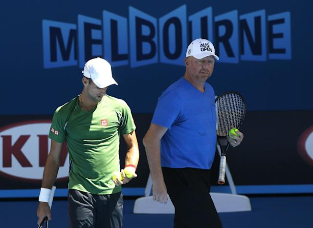 Novak Djokovic, left, of Serbia walks with former Grand Slam champion and coach Boris Becker of Germany during a training session ahead of the Australian Open tennis championship in Melbourne, Australia, Sunday, Jan. 12, 2014. (AP Photo/Eugene Hoshiko)