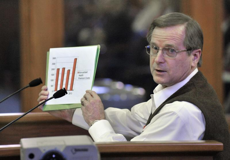 Jim Pearson, a Huron Valley Schools retiree, shows a chart as he testifies before a Senate Appropriations retirement subcommittee considering a bill that would make school employees pay more to keep their pensions, Wednesday, April 11, 2012 in Lansing, Mich. (AP Photo/Detroit News, Dale G. Young) DETROIT FREE PRESS OUT; HUFFINGTON POST OUT