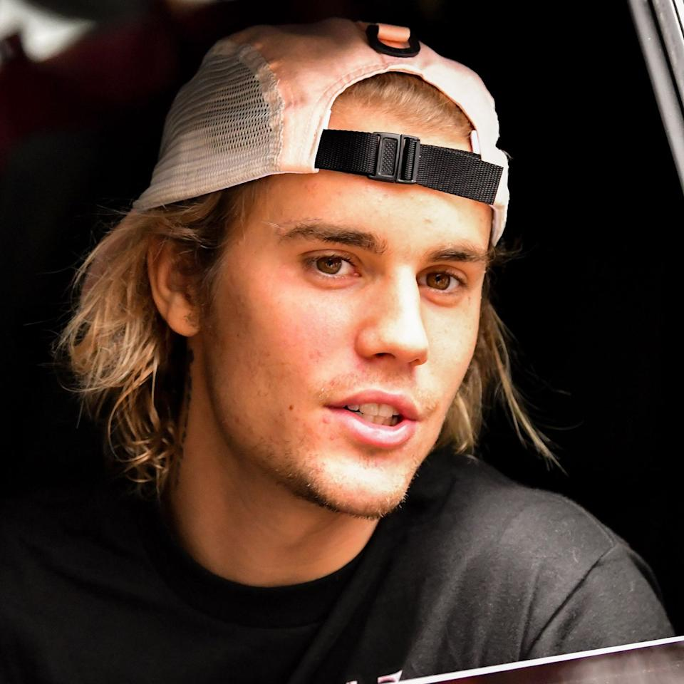 "<p>In early November, news broke that Justin Bieber is sporting some new face ink—but it's so subtle, it took fans a while to notice it. </p><p>In an interview with <a href=""https://pagesix.com/2018/11/02/justin-bieber-has-a-new-face-tattoo/"" target=""_blank"">Page Six</a>, Bieber's go-to tattoo artist, Bang Bang, (real name Keith McCurdy) confirmed that the new face tat is real and that Justin got it as part of a couple's tattoo with Hailey Baldwin. He wouldn't say much about the ink, but said it was ""little words"" next to Justin's eyebrow. Squint and you can see there's <em>something</em> there in this picture from July—but if you can make out what it says, you should register with the government as a superhero because your vision is inhuman.</p><p><em>""</em>They each got a tattoo,"" McCurdy said of the ink. ""Justin's tattoo is on his face, and I haven't seen any photos of it—so he's doing a good job of laying low...It's really thin and delicate. And [it's] also not a traditional couples' tattoo...I don't want to give away what it is until press gets a hold of it.""</p>"