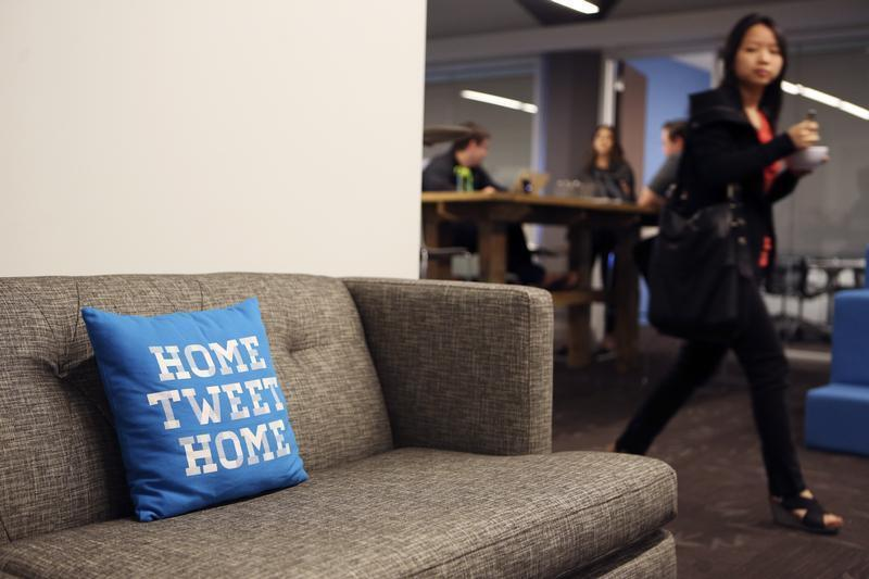 A pillow is placed on a couch at Twitter headuiarters in San Francisco