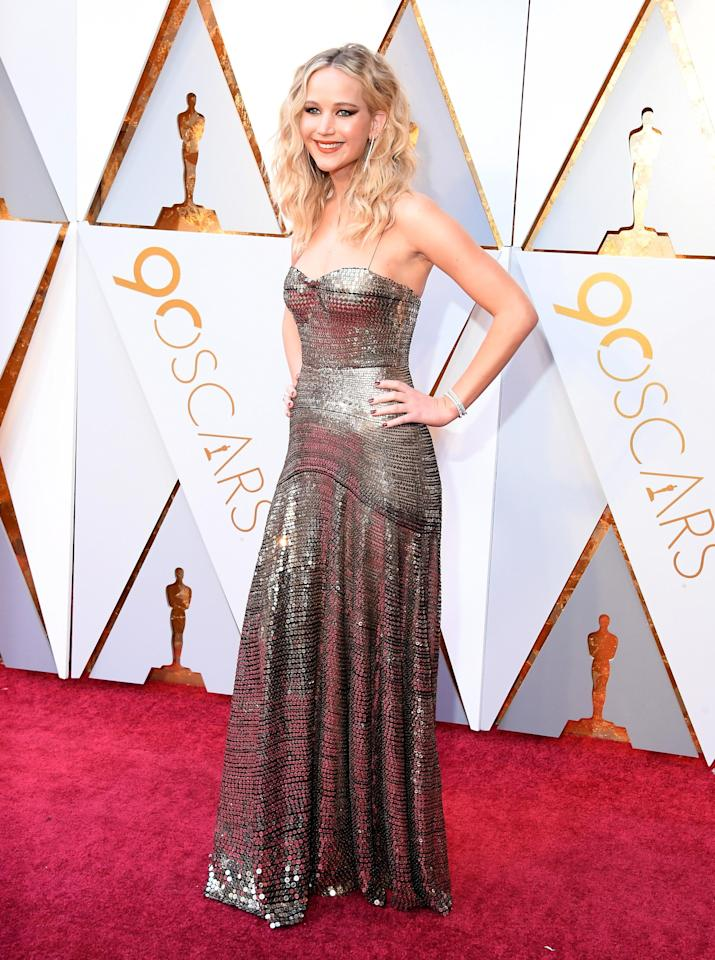 <p>Golden girl JLaw can do no wrong - and that includes her skintight metallic Dior that hugged every inch of her incredible figure.</p>