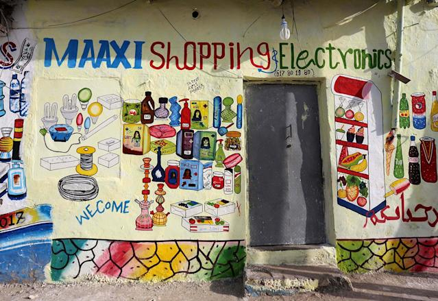 <p>A mural on the wall of a shop illustrates electrical appliances, cosmetics and beverages in Hamarweyne district of Mogadishu, Somalia, June 8, 2017. (Photo: Feisal Omar/Reuters) </p>