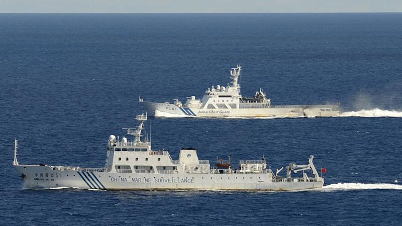 The Chinese surveillance ship Haijian No. 51, front, sails ahead of a Japan Coast Guard vessel in waters near disputed islands, called Senkaku in Japan and Diaoyu in China, in the East China Sea on Friday morning, Sept. 14, 2012. The Japanese government and coast guard say six Chinese surveillance ships entered Japanese waters Friday near disputed islands in the East China Sea, prompting the prime minister's office to mobilize a task force at its crisis management center. (AP Photo/Kyodo News) JAPAN OUT, MANDATORY CREDIT, NO LICENSING IN CHINA, HONG KONG, JAPAN, SOUTH KOREA AND FRANCE