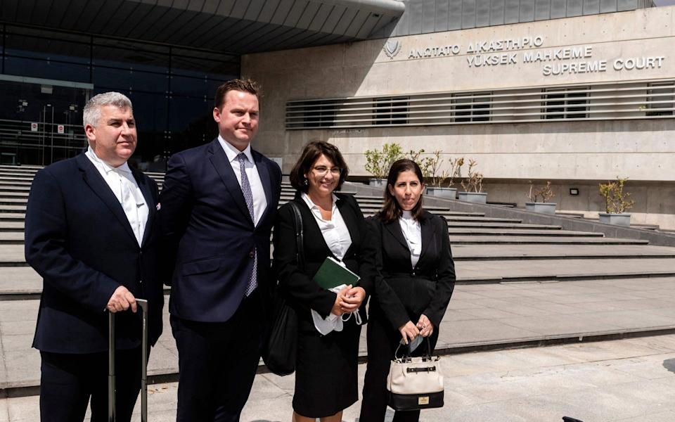 The woman's defence team - (L-R) Lewis Power, Michael Polak, Nikoleta Charalabidou and Ritsa Pekri, in front of the Supreme Court in the Cypriot capital Nicosia - AFP