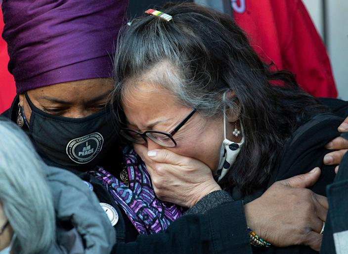 Jo-Ann Yoo, executive director of the Asian American Federation, cries after speaking in March at a press conference outside a building where a 65-year-old Asian American woman was attacked in New York. The attack, which took place on a sidewalk in broad daylight in Midtown Manhattan on March 29, was caught on CCTV footage from inside an adjacent building.