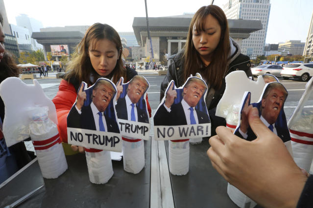 <p>Protesters display pictures of President Donald Trump during a rally to oppose his planned visit near the U.S. Embassy in Seoul, South Korea, Saturday, Nov. 4, 2017. (Photo: Ahn Young-joon/AP) </p>