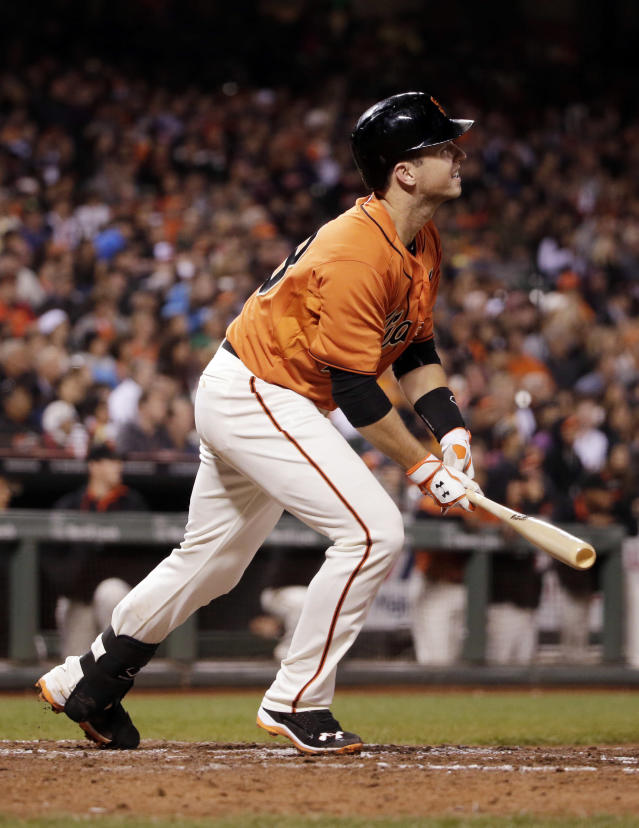 San Francisco Giants' Buster Posey watches his two-run triple against the Milwaukee Brewers during the fifth inning of a baseball game Friday, Aug. 29, 2014, in San Francisco. (AP Photo/Marcio Jose Sanchez)