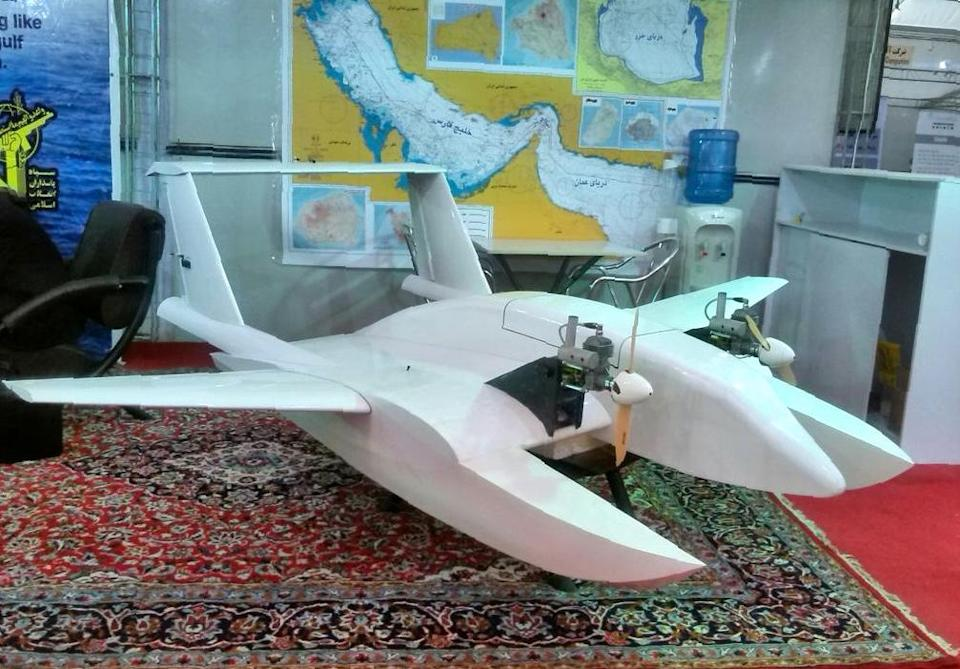 """Iran's elite Revolutionary Guards display a """"suicide drone"""" capable of delivering explosives to blow up targets at sea and on land, in Tehran on October 26, 2016 (AFP Photo/Handout)"""