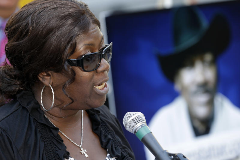 Boxing legend Joe Frazier's daughter Renae Frazier-Martin speaks during a news conference announcing a fundraising campaign for a sculpture of her father, outside of City Hall, Wednesday, Sept. 12, 2012, in Philadelphia. The statue is expected to be placed at Xfinity Live, an entertainment complex near Philadelphia's three sports stadiums. (AP Photo/Matt Rourke)