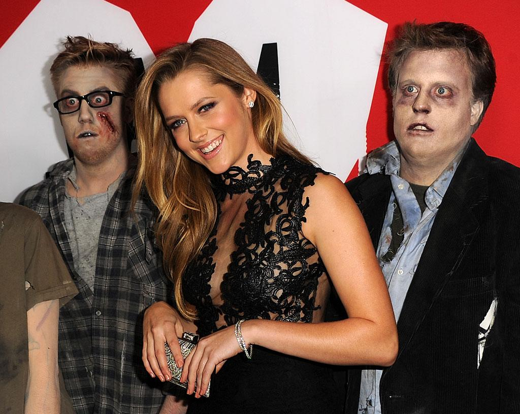 "HOLLYWOOD, CA - JANUARY 29:  Actress Teresa Palmer and zombies arrive for the Los Angeles premiere of Summit Entertainment's ""Warm Bodies"" at ArcLight Cinemas Cinerama Dome on January 29, 2013 in Hollywood, California.  (Photo by Kevin Winter/Getty Images)"