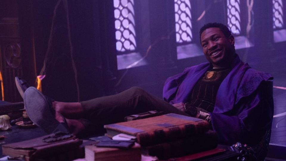 He Who Remains smiles with his feet on his desk at his office in the Citadel on Loki, a part of the MCU's multiverse